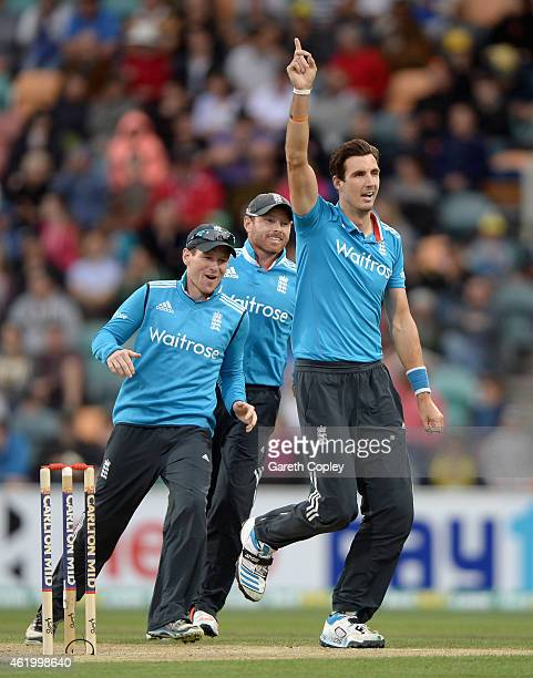 Steven Finn of England celebrates with teammates Eoin Morgan and Ian Bell after dismissing Cameron White of Australia during the One Day...