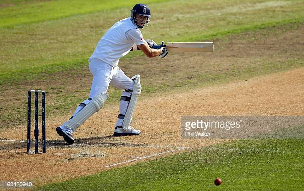 Steven Finn of England hits a four during day five of the First Test match between New Zealand and England at University Oval on March 10, 2013 in...