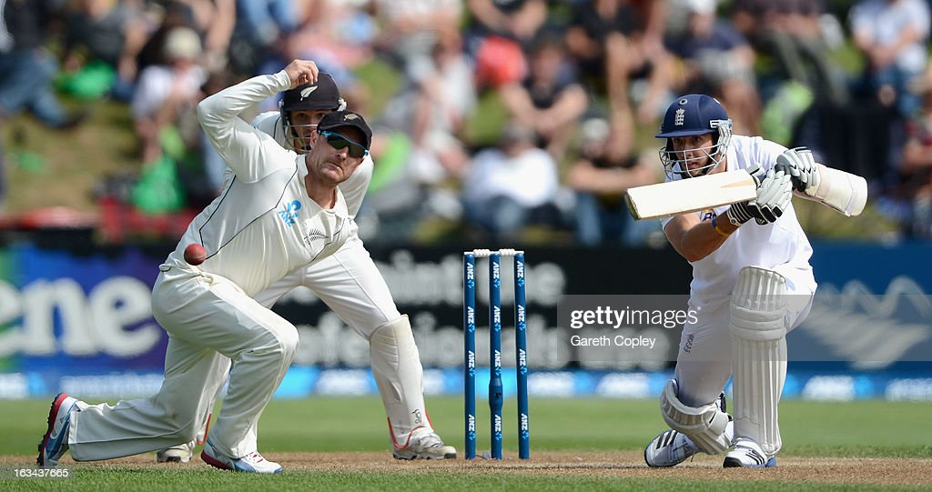 Steven Finn of England hits past New Zealand captain Brendon McCullum during day five of the First Test match between New Zealand and England at University Oval on March 10, 2013 in Dunedin, New Zealand.