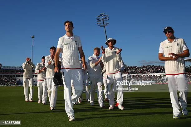 Steven Finn of England is applauded by team mates at the end of play after taking 5 for 45 during day two of the 3rd Investec Ashes Test match...