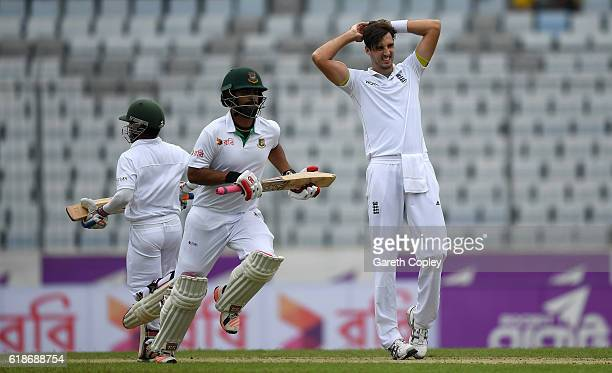 Steven Finn of England reacts as Tamim Iqbal and Mominul Haque of Bangladesh score runs during the first day of the 2nd Test match between Bangladesh...