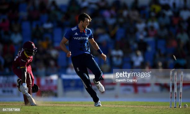 Steven Finn of England runs out Jason Mohammed of the West Indies during the first One Day International between the West Indies and England at Sir...