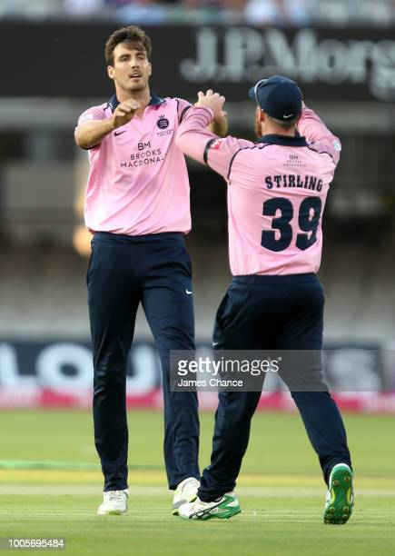 Steven Finn of Middlesex celebrates bowling and catching James Vince of Hampshire with Paul Stirling of Middlesex during the Vitality Blast match...