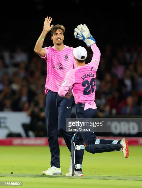 Steven Finn of Middlesex celebrates with John Simpson of Middlesex after dismissing Rikki Clarke of Surrey during the Vitality T20 Blast match...