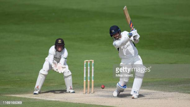 Steven Finn of Middlesex hits out during the Specsavers County Championship: Division Two match between Sussex and Middlesex at The 1st Central...