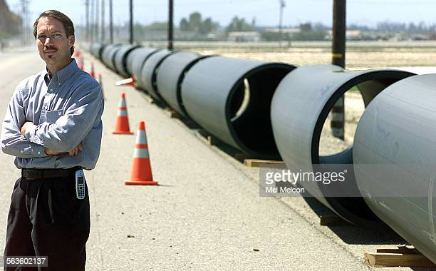 Steven Fiori Senior Project Manager for Calleguas Municipal Water District in eastern Ventura County stands next to sections of 54 inch diameter high...
