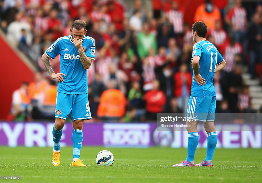Steven Fletcher (L) and Adam Johnson of Sunderland look dejected during the Barclays Premier League match between Southampton and Sunderland at St Mary's Stadium on October 18, 2014 in Southampton, England.