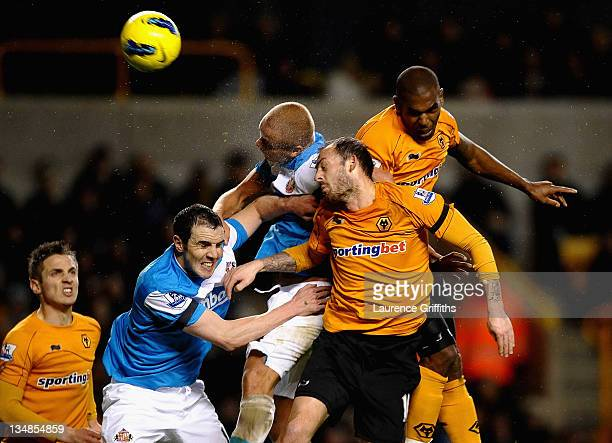 Steven Fletcher and Ronald Zubar of Wolverhampton Wanderers compete for a header with John O'Shea and Wes Brown of Sunderland during the Barclays...