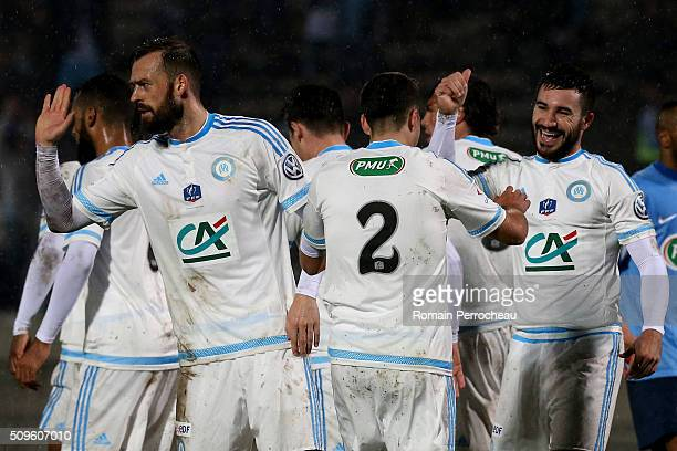 Steven Fletcher Javier Manquillo and Romain Alessandrini of Olympique de Marseille celebrates after scoring 10 during the French Cup match between...