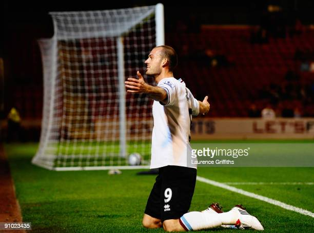 Steven Fletcher of Burnley celebrates after scoring the opening goal during the Carling Cup Third Round game between Barnsley and Burnley at Oakwell...