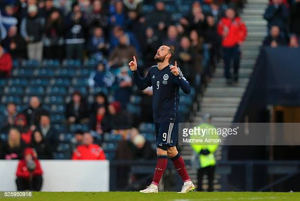 Steven Fletcher of Scotland celebrates after scoring a goal to make it 61