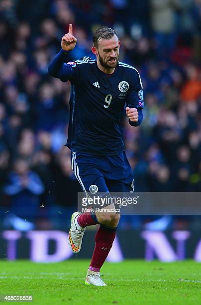 Steven Fletcher of Scotland celebrates scoring his hat trick and Scotland's sixth goal during the EURO 2016 Qualifier match between Scotland and...