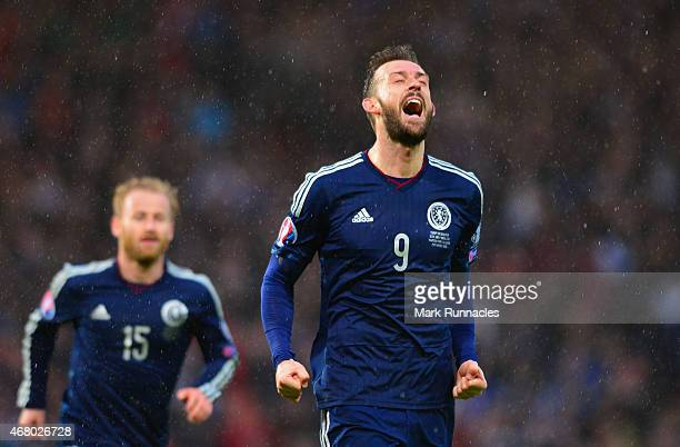 Steven Fletcher of Scotland celebrates scoring their fifth goal during the EURO 2016 Qualifier match between Scotland and Gibraltar at Hampden Park...