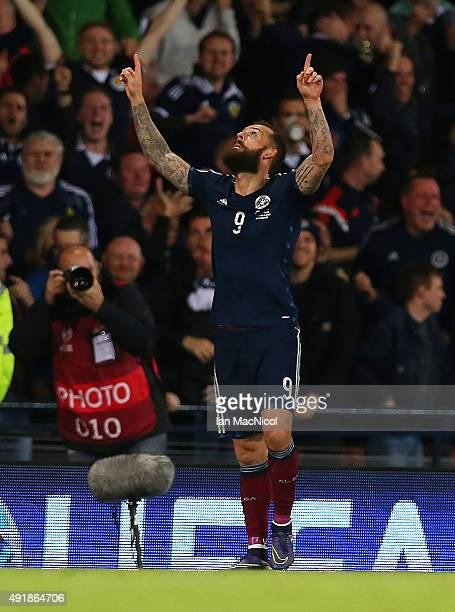 Steven Fletcher of Scotland celebrates scoring their second goal during the UEFA EURO 2016 qualifier between Scotland and Poland at Hampden Park on...