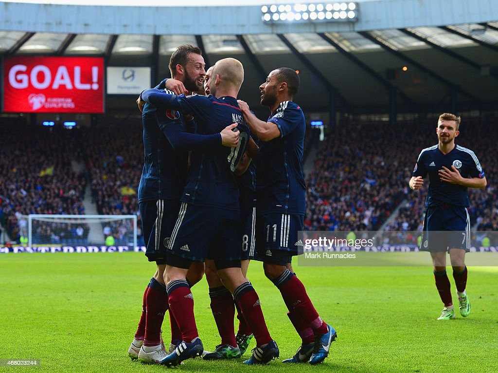 Steven Fletcher of Scotland (L) celebrates scoring their second goal with team mates during the EURO 2016 Qualifier match between Scotland and Gibraltar at Hampden Park on March 29, 2015 in Glasgow, Scotland.