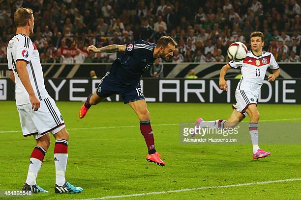 Steven Fletcher of Scotland heads at the Germany goal during the EURO 2016 Group D qualifying match between Germany and Scotland at Signal Iduna Park...