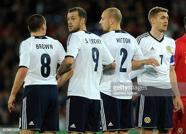 Steven Fletcher of Scotland in the defence wall