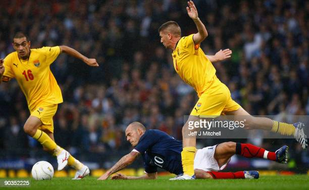 Steven Fletcher of Scotland is tackled by Veliche Shumulikoski and Slavcho Georgievski of Macedonia during the FIFA 2010 World Cup Qualifier match...