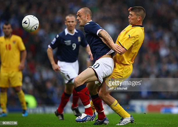Steven Fletcher of Scotland is tackled by Veliche Shumulikoski of Macedonia during the FIFA 2010 World Cup Qualifier match beteween Scotland and...