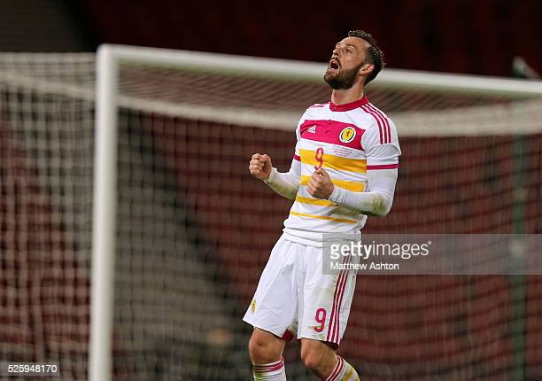 Steven Fletcher of Scotland reacts after missing a chance to score