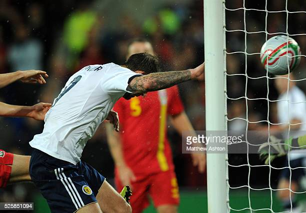 Steven Fletcher of Scotland scores a goal but it was ruled that the ball had gone out of play