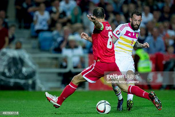 Steven Fletcher of Scotland scores their fourth goal against Roy Chipolina of Gibraltar during the UEFA EURO 2016 Qualifying round Group G match...