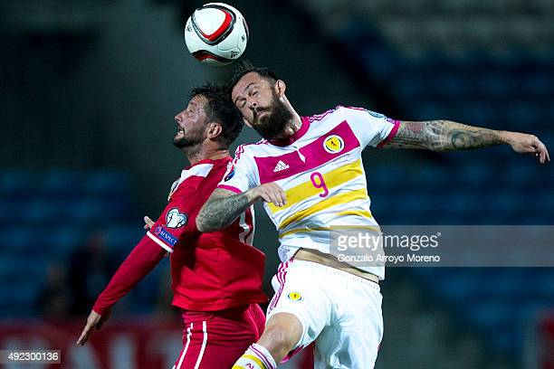 Steven Fletcher of Scotland wins the header after Daniel Duarte of Gibraltar during the UEFA EURO 2016 Qualifying round Group G match between...