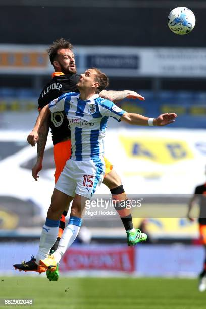 Steven Fletcher of Sheffield Wednesday and Chris Lowe of Huddersfield Town battle to win a header during the Sky Bet Championship Play Off Semi Final...