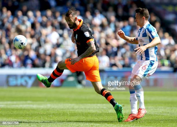 Steven Fletcher of Sheffield Wednesday and Jonathan Hogg of Huddersfield Town look on during the Sky Bet Championship Play Off Semi Final 1st leg...