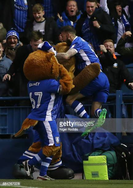 Steven Fletcher of Sheffield Wednesday celebrates scoring his sides first goal with the Sheffield Wednesday mascots during the Sky Bet Championship...
