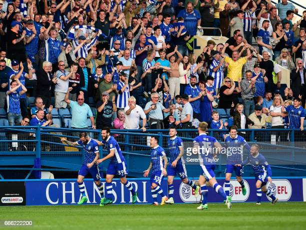 Steven Fletcher of Sheffield Wednesday celebrates with teammates after scoring Sheffield's second goal during the Sky Bet Championship Match between...
