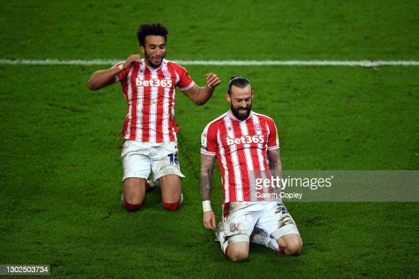 Steven Fletcher of Stoke City celebrates with team mate Jacob Brown after scoring their side's first goal during the Sky Bet Championship match...