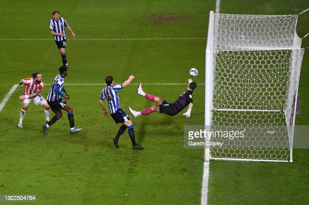 Steven Fletcher of Stoke City scores their side's first goal past Keiren Westwood of Sheffield Wednesday during the Sky Bet Championship match...