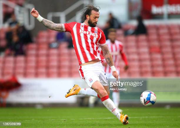 Steven Fletcher of Stoke City shoots during the Sky Bet Championship match between Stoke City and Brentford at Bet365 Stadium on October 24 2020 in...