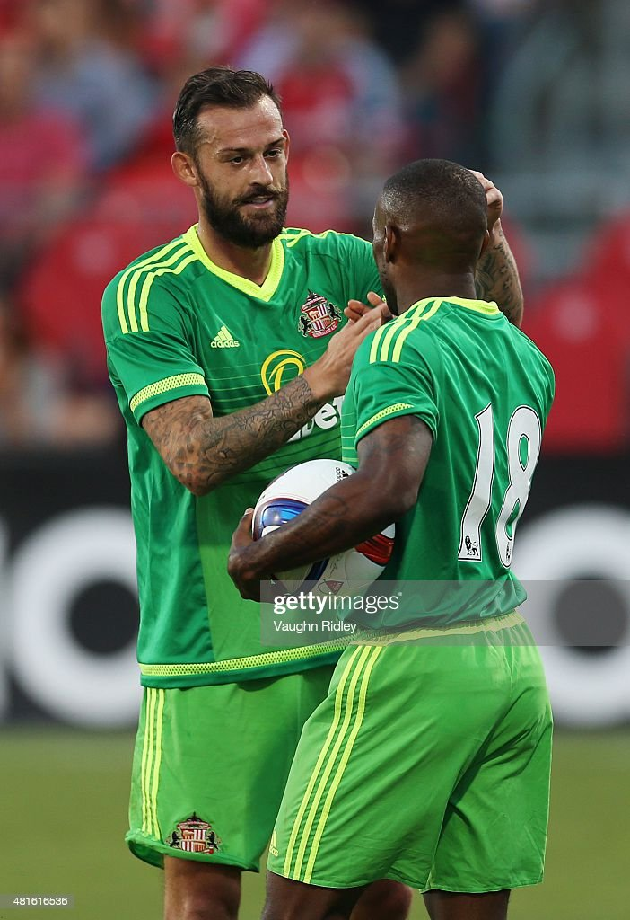 Steven Fletcher #9 of Sunderland AFC congratulates Jermain Defoe #18 after he scored his second goal during a friendly match against Toronto FC at BMO Field on July 22, 2015 in Toronto, Ontario, Canada.