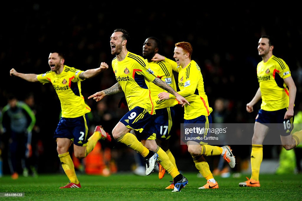 Steven Fletcher of Sunderland and his teammates celebrate their team's 2-1 victory in the penalty shootout during the Capital One Cup semi final, second leg match between Manchester United and Sunderland at Old Trafford on January 22, 2014 in Manchester, England.
