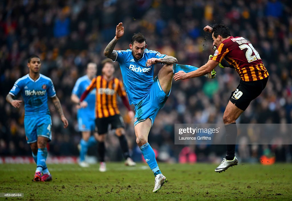 Steven Fletcher of Sunderland battles for the ball with Filipe Morais of Bradford during the FA Cup Fifth Round match between Bradford City and Sunderland at Coral Windows Stadium, Valley Parade on February 15, 2015 in Bradford, England.