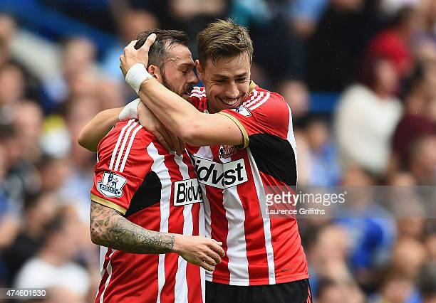 Steven Fletcher of Sunderland celebrates scoring his team's first goal with his team mate Sebastian Coates during the Barclays Premier League match...