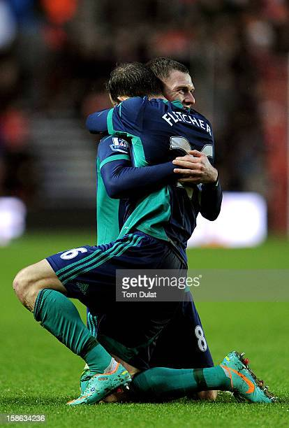 Steven Fletcher of Sunderland is congratulated by teammate Craig Gardner after scoring his team's opening goal during the Barclays Premier League...