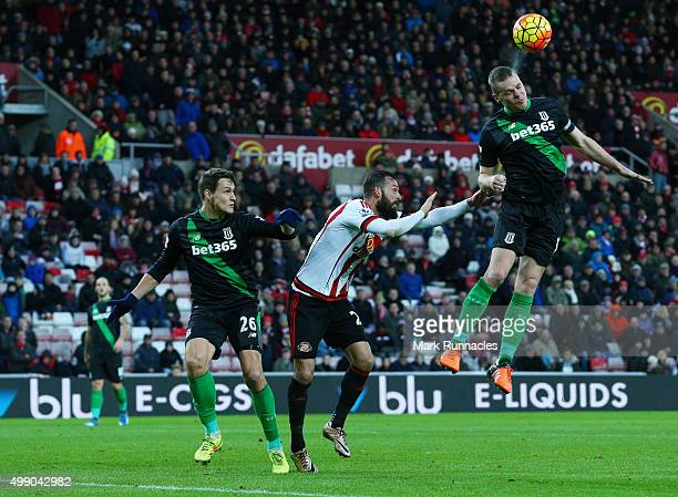 Steven Fletcher of Sunderland is out jumped by Glenn Whelan of Stoke during the Barclays Premier League match between Sunderland AFC and Stoke City...