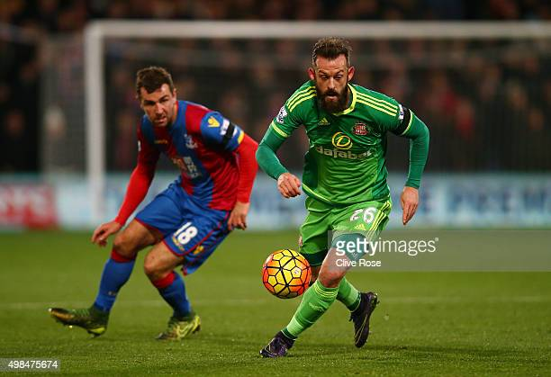 Steven Fletcher of Sunderland is pursued by James McArthur of Crystal Palace during the Barclays Premier League match between Crystal Palace and...