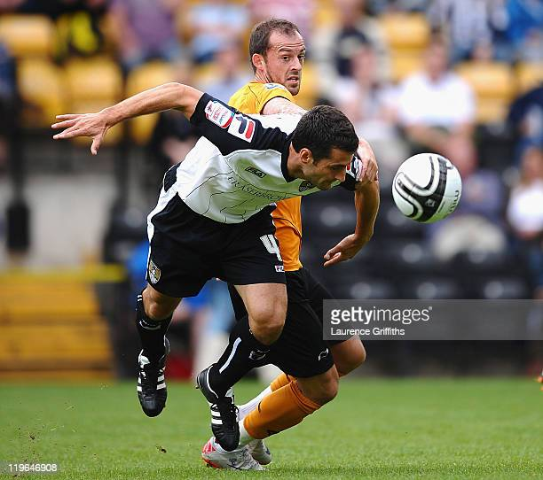 Steven Fletcher of Wolves battles with Mike Edwards of Notts County during the Pre Season Friendly between Notts County and Wolverhampton Wanderers...