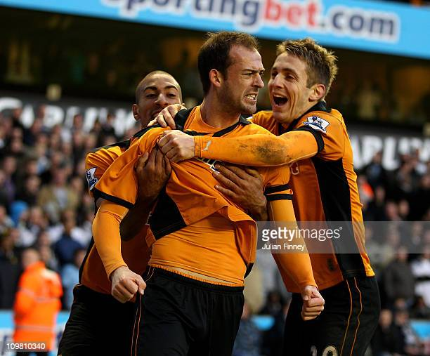 Steven Fletcher of Wolves celebrates scoring the equalising goal with teammates Karl Henry and Kevin Doyle during the Barclays Premier League match...