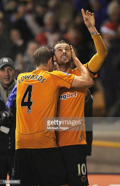 Steven Fletcher of Wolves celebrates scoring to make it 11 with team mate David Edwards during the Barclays Premier League match between...