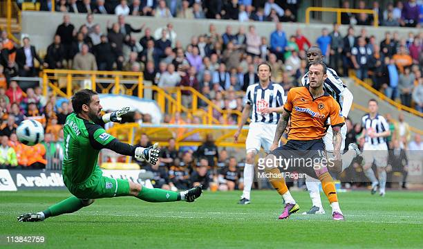 Steven Fletcher of Wolves shoots past Scott Carson of West Brom and scores to make it 30 during the Barclays Premier League match between...