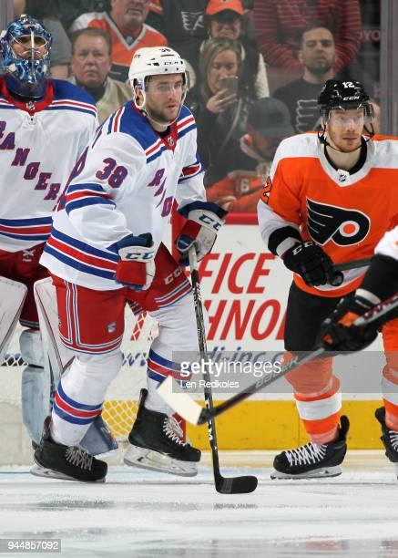Steven Fogarty of the New York Rangers skates against Michael Raffl of the Philadelphia Flyers on April 7 2018 at the Wells Fargo Center in...