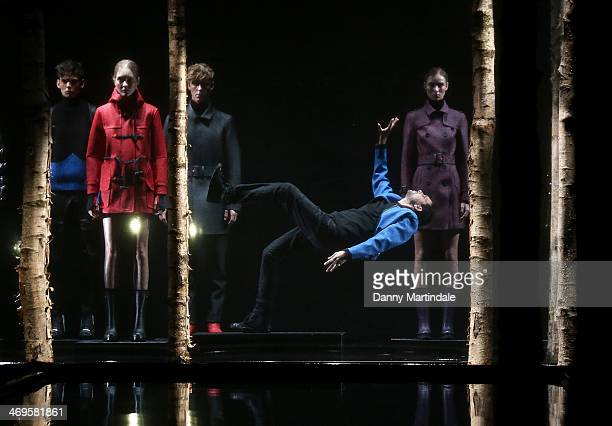 Steven Frayne aka Dynamo does a levitation trick at the end of the runway at the Hunter Original show at London Fashion Week AW14 at University of...