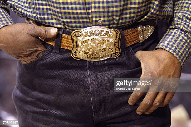 Steven Gabriel of Houston Texas wears a gold and silver cowboy belt buckle from the National Black Rodeo Finals on November 13 2004 at the CenturyTel...