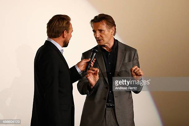 Steven Gaetjen and Liam Neeson seen on stage after the 'A walk amongst the Tombstones' Green Carpet Arrivals during Day 9 of Zurich Film Festival...