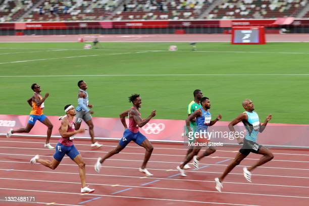 Steven Gardiner of Team Bahamas leads the field as he goes on to win the gold medal in the Men's 400m Final on day thirteen of the Tokyo 2020 Olympic...